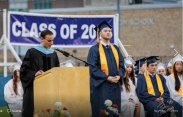 Principal John Harrison reads Zach's plans and scholarships