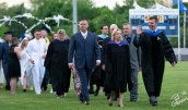 Administrators and faculty lead the procession.