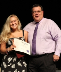 "Meghan Dion received the National Leadership ""I Dare You"" Award from Dean Fredrick Damon"