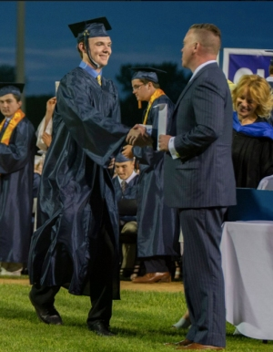 Sam Gray receives his diploma from Dan Biggins, Chairman of the Rockland School Committee