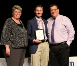 Ms Paudling and Mr Damon with sophomore, Tyler Beatrice who won the overall academic achievement award.