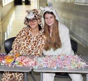 Krysta Doherty and Ali Landy are ready for trick-or-treaters. photo by Arianna Esposito