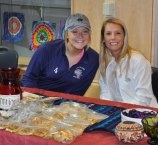 Seniors Meghan Dion and Lexi Nastasia selling baked goods at the Guatemala bake sale.