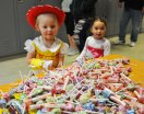 Trick-or-treaters 3 year old Kayleigh Jank (left) of Rockland and 2 year old Mckenzie Arroyo of Bridgewater will choose from the array of candy options at the Rockland Student Government sponsored Project Pumpkin held at Rockland High School on Sunday Oct. 28. photo by Arianna Esposito, Veritas Staff