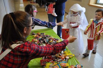 Jessie DeMarco and Stephanie Beatrice add candy to the bags of trick-or-treaters. photo by Ari Esposito