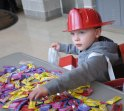 A little fireman helps himself to some candy. photo by Ari Esposito