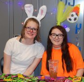 Juniors Lara Glennon and Molly Boggs paired as a rabbit and carrot at their stop on teh candy trail. Photo by Arianna Esposito