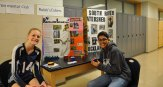 Hannah Wylie and Jad Bendarkawi at the Environmental Club and Rubik's Cube table.