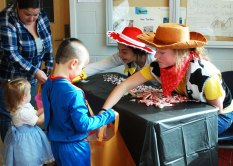 Trick or treaters got to fill their bags at stations in the hallways.