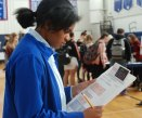 Allison Whitman looks over her finances at the Credit Fair for sophomores on Nov. 7.
