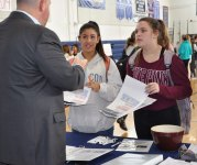Mr. Jeff Phelps of Amos A. Phelps Insurance explains some things about insurance to Jeileanie Tejeda and Catherine Hailer.