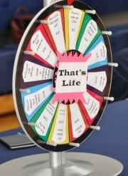 Sophomores spin the wheel and receive an unexpected bill or bonus.