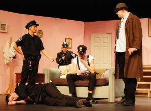 Justin Sherlock (left) as Officer Brophy, Cailin Sullivan as Officer Klein, Tyler Beatrice as Officer O'Hara and Jonah Pishkin as Lt. Rooney discuss the criminal Jonathan Brewster who lies on the floor.