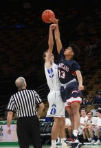 Aneuris Quezada takes the tip at the opening of the game.