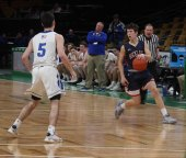 Hunter Wardwell looks to drive to the hoop.
