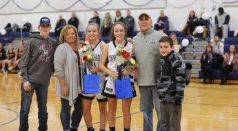 Nicole and Maddie with their family