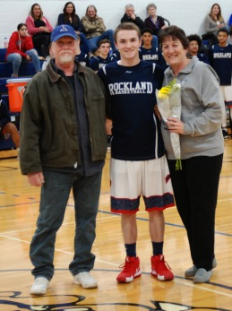Peter Kohler with his parents.