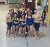 Swimming seniors and their coaches on Senior Night.