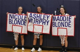 seniors with signs
