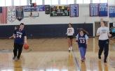 Alex Anzivino dribbles up the floor as Ashley Murphy and Cailin Sullivan follow. Veritas photo