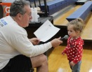 Mr. Graziano gets some help announcing the game from his granddaughter. Veritas photo