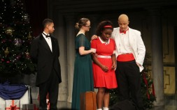 """Annie is sad that she cannot stay with """"Daddy Warbucks."""" From left is Terell Wright, Bonnie Gasdia, Mikayla Andre and Jordan Cunningham. Veritas photos"""