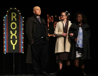 Warbucks, Miss Farrell and Annie in NYC.