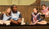 In the orphanage: from left: Emily Gillooly (5th grade), Mikayla Andre (9th grade), Kyara Williams (5th grade) and McKenna Maher (7th grade). Veritas photo