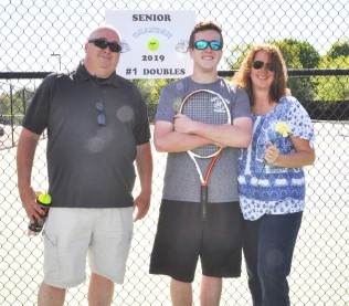 Brandon Gallagher and his parents