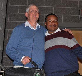 "Antonio Gilstrap received the ""Jimbo"" Award from Jimmy Cahill."