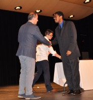 John Piazza presents Mireese Wilson with a music award.