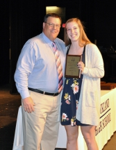 Caroline Elie received the Grade 11 Math Award from Mr. Damon