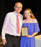 Mr. Cable-Murphy presents Erin Kearns with the Grade 11 Digital Media and Communications Award