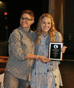 Junior Maddie Gear receives a Global Ambassador Award from Ms. Hoyo