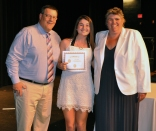 Grace Henry receives a Youth Leadership Award from Mr. Damon and Ms. Paulding