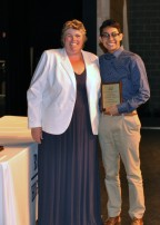 Jad Bendarkawi received the Overall Academic Achievement Award for Grade 11 from Ms. Paulding