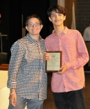 Kevin Matos Donorato Soares Campos received the Grade 9 Science Award from Ms. Hoyo