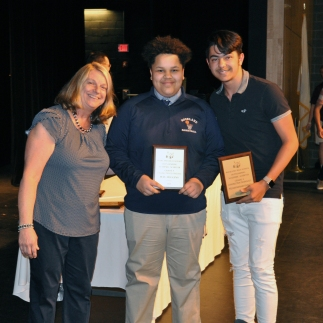 Mrs. Folsom presents Max Huggins and William Maynard-Pimental the Construction Technology Award for Grade 9.