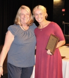 Junior Mia Comean receives the Physical Ed. Award from Mrs. Folsom