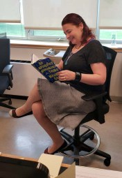 Mrs. Armstrong takes a break with her book.