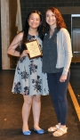 Ms. McComb presents Ngan Nguyen with the Grade 9 Academic Achievement Award for Music