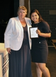 Nicole Ligia Guidel Winter received a Grade 11 Multi-Award plaque from Ms. Paulding