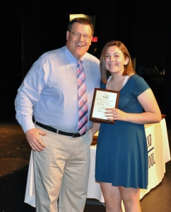 Olivia Jones received Grade 9 Math Award from Mr. Damon