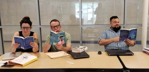 Ms. Medeiros, Mr. Bigsby and Mr. Ricci are relaxing with their books from the Summer Reading list.