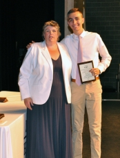 Junior Tyler Johnson received an award in multiple subjects from Ms. Paulding