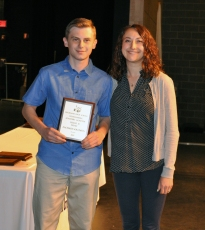 Zachary Solomon, grade 10, received an academic award in Music from Ms. McComb.