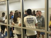 Mentors show incoming freshmen around the high school on August 21.