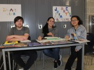 Bryce Taylor, Jessica Driscoll and Danting Zhu at the Art Club table.