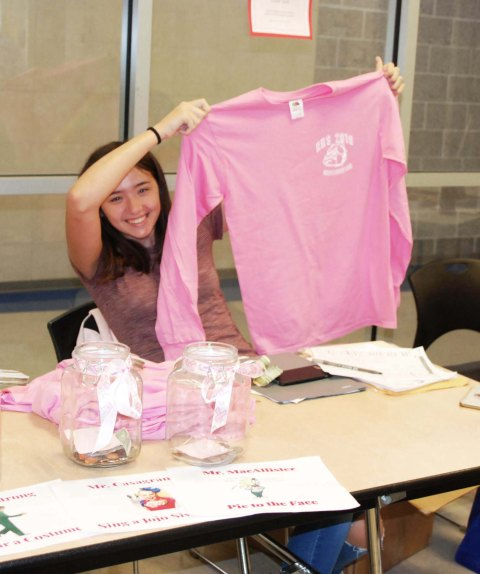 Livi Dalton selling t-shirt in caf.