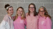 From left: Sydney Blaney, Katy Buckley, Lara Glennon, Maddie Gear pose in their pink-out gear. The high school and middle school held pink-out days to help raise awareness and collect funds for the American Cancer Society. photo by Alana Miller